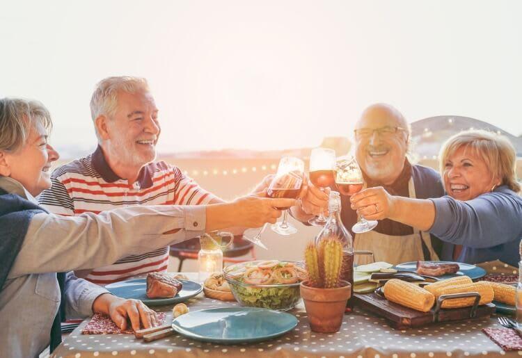 Senior friends enjoying dinner at home