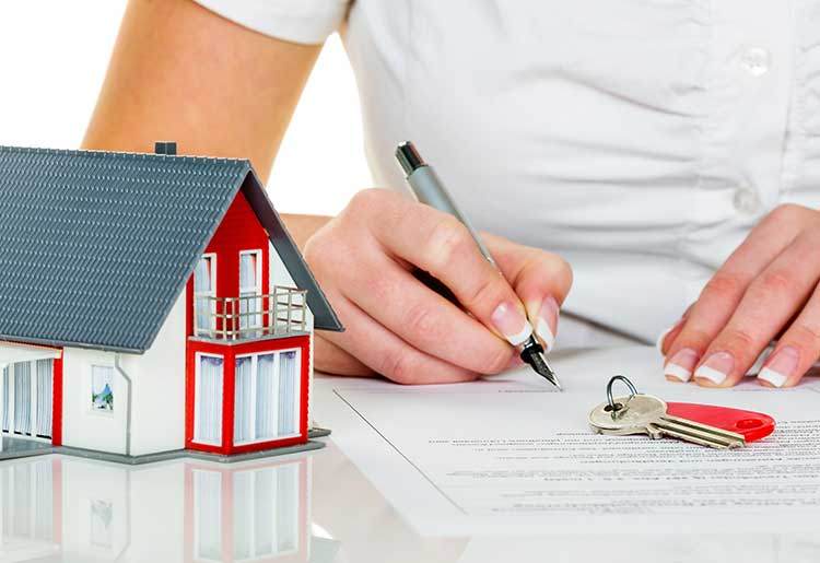 Man signing a home warranty plan