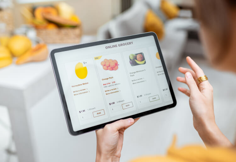 A young woman orders groceries online