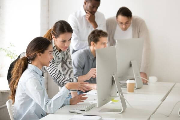 A business team using a CRM software