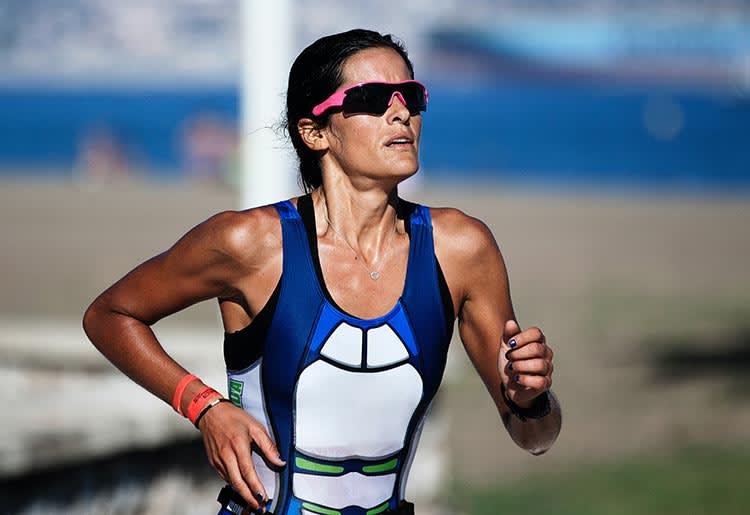 A female long distance runner during a race.