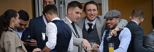 English footballers Samir Carruthers, Luke Ayling and Jameds Collins behaving badly at Cheltenham